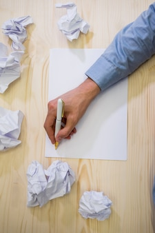 Hands of business executive writing on blank paper