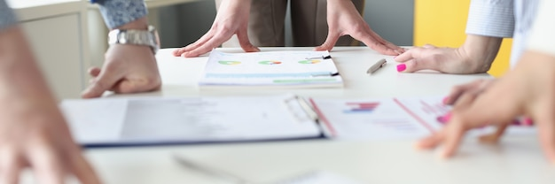 Hands of business people at work table with commercial charts. business analytics and company development strategy concept