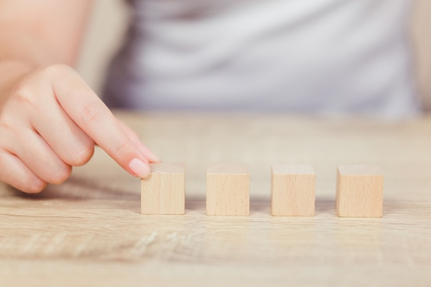 Hands of business,stacking wooden blocks.