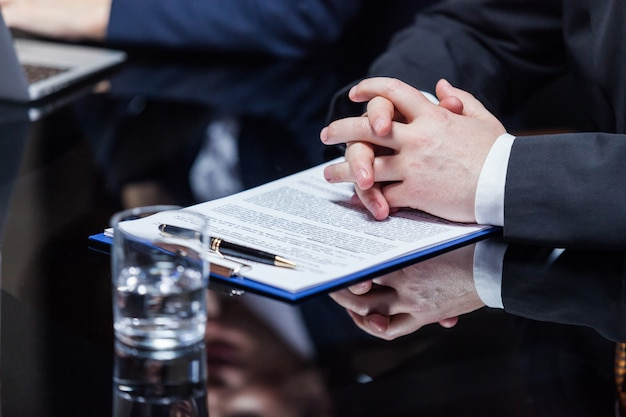 Hands of businessman on papers
