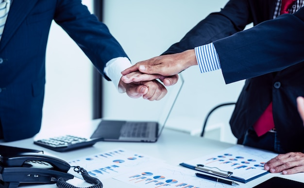Hands of businessman support teamwork, community of colleagues business.