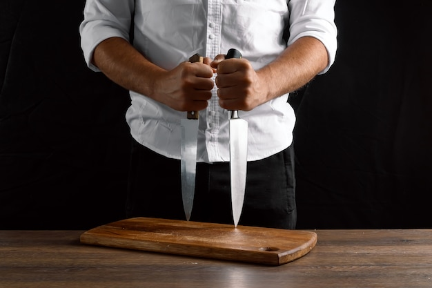 Hands of the chef  with a knives