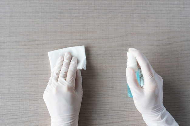 Hands cleaning disinfection high-touch household surface. top view