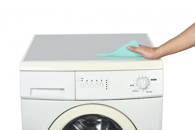 Hands cleaning the washing machine with a washcloth
