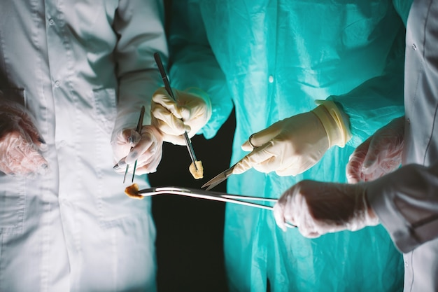 Hands close-up of surgeons holding medical instruments. the surgeon makes an operation.