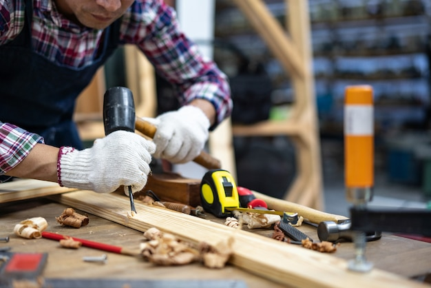 Hands of craftsman carve with a gouge