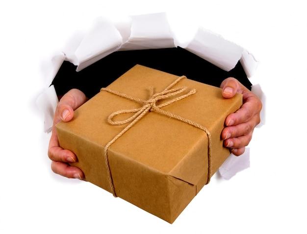 Hands delivering mail package