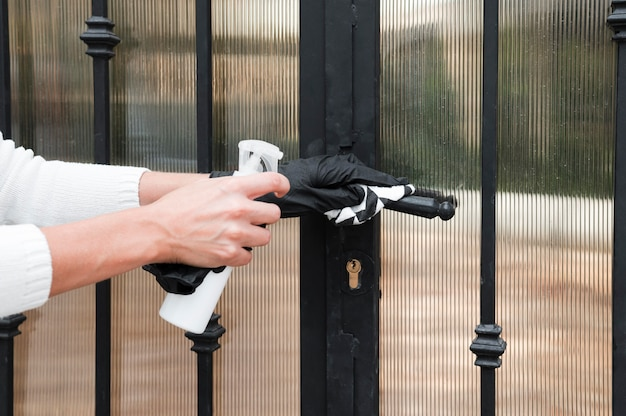 Hands disinfecting gate handle