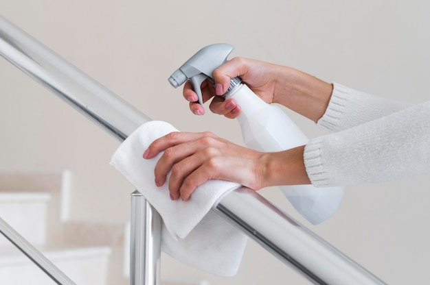 Hands disinfecting hand rail