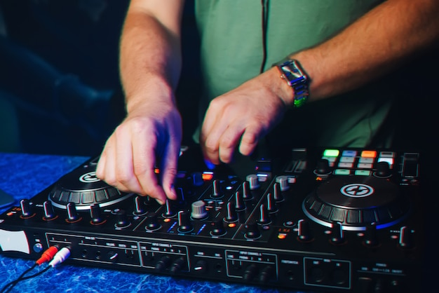 Hands of the dj on the mixer