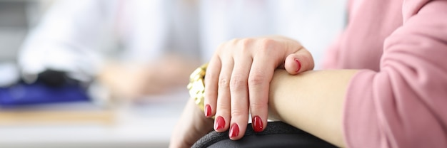 Hands of doctor and patient in medical office medical assistance
