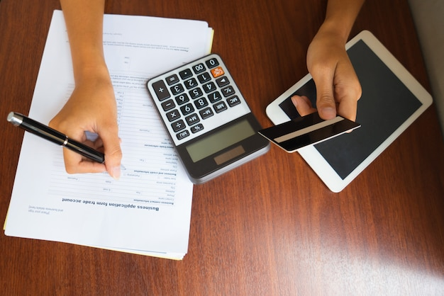 Hands of female accountant filling financial form