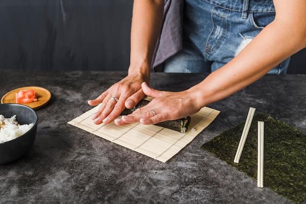Hands finishing wrap