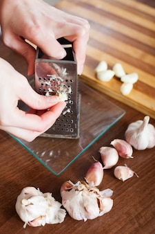 Hands  grating garlic
