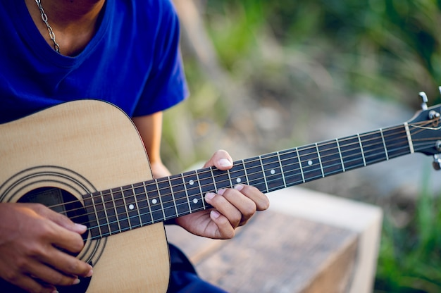 Hands and guitars of guitarists playing guitar, musical instruments