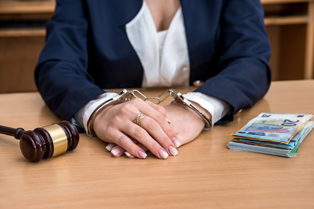 Hands in handcuffs arrested for bribe with euro bills