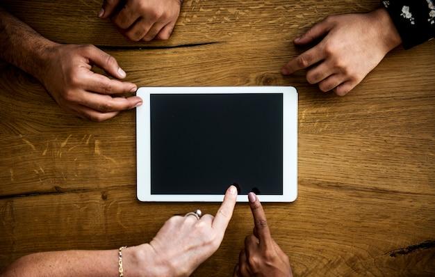 Hands hold digital tablet copy space together