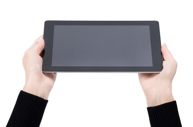 격리된 화면이 있는 태블릿 터치 컴퓨터 가젯을 들고 있는 손