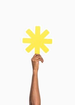 Hands holding an asterisk symbol