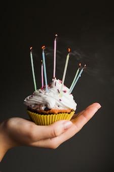 Hands holding birthday muffin
