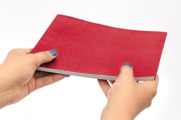 Hands holding black book