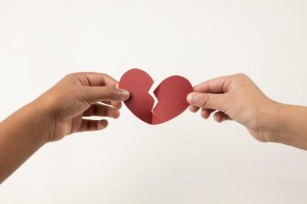 Hands holding a broken heart, heartbreak concept