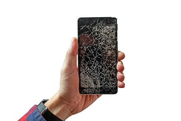 Руки держат сломанный мобильный смартфон со сломанным экраном, изолированным на белом фоне. треснувшее стекло на черном телефоне в виде паутины.