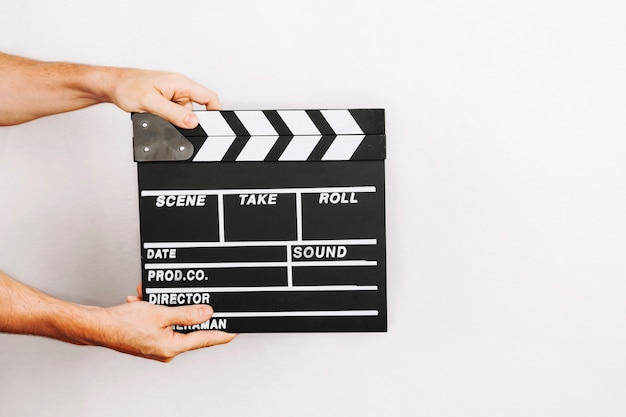 Hands holding clapboard