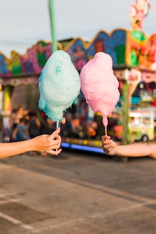 Hands holding cotton candy