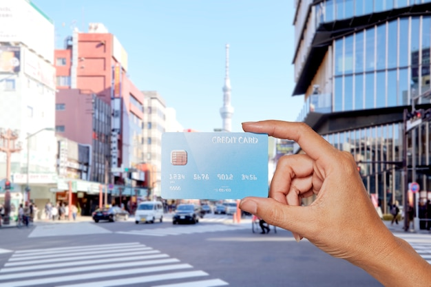 Hands holding credit card city