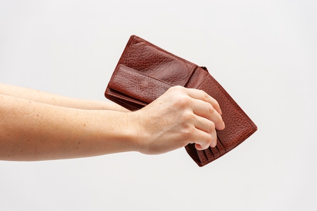 Hands holding empty leather wallet