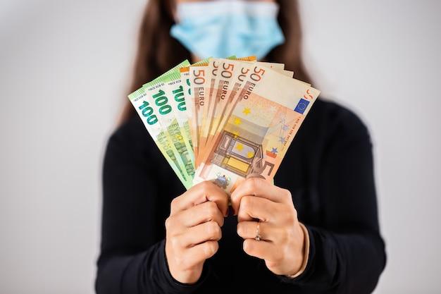 Hands holding euro cash during coronavirus pandemic