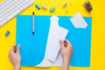 Hands holding folder on desktop