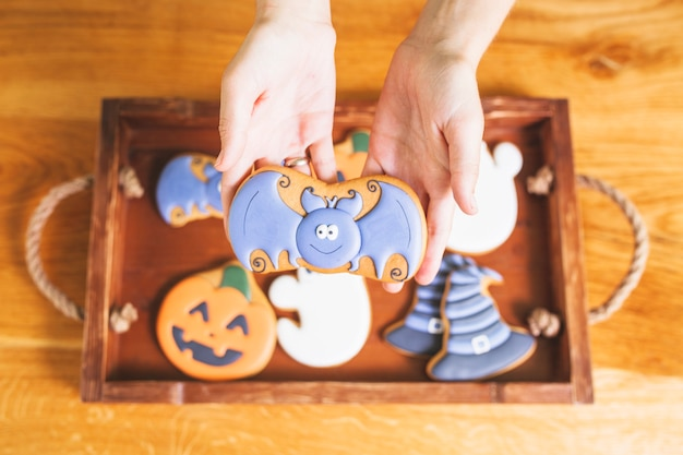 Hands holding funny gingerbread
