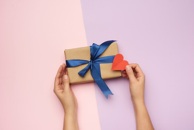 Hands holding a gift paper box