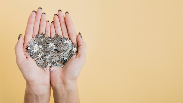 Hands holding glitter with copy space flat lay