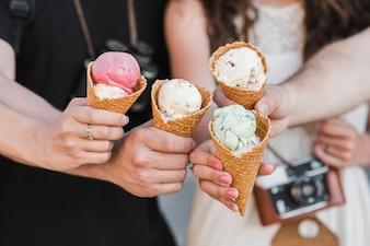 Hands holding ice cream cones