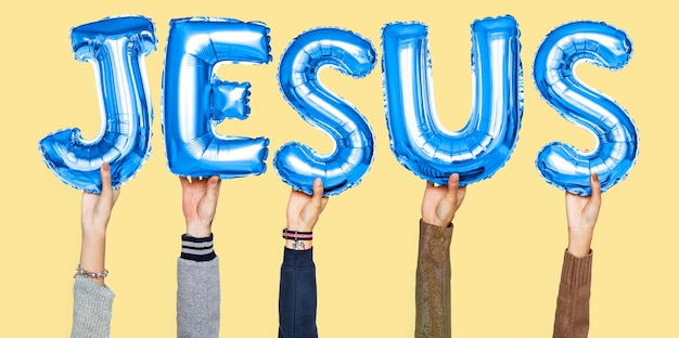 Hands holding jesus word in balloon letters