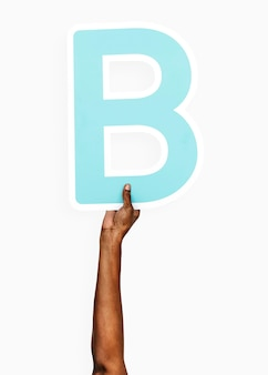 Hands holding the letter b