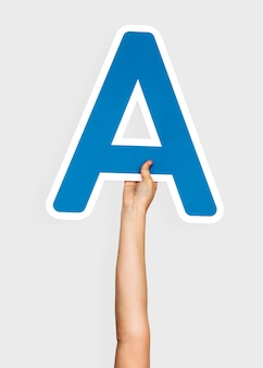 Hands holding the letter a