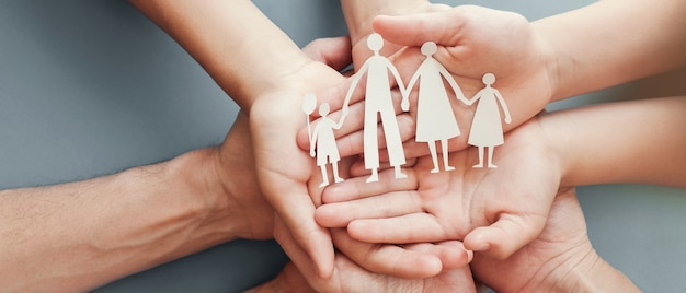 Hands holding paper family