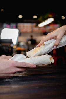 Hands holding shawarma. fast food concept