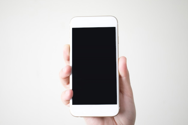 Hands holding a smart phone with a black screen