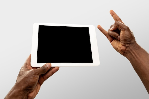 Hands holding tablet, copyspace for ad. white background