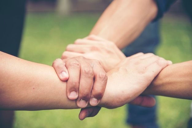 Hands holding trust each other with success partnership concept.  business partners holding hands together as triangle