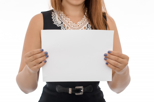 Hands holding white paper sheet