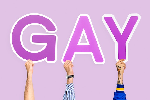 Hands holding the word gay