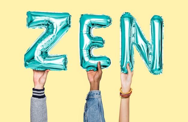 Hands holding zen word in balloon letters