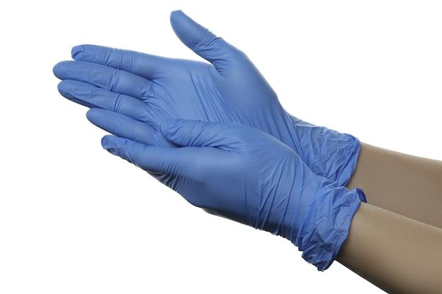 격리 된 흰색 배경에 고립 된 의료 장갑에 손