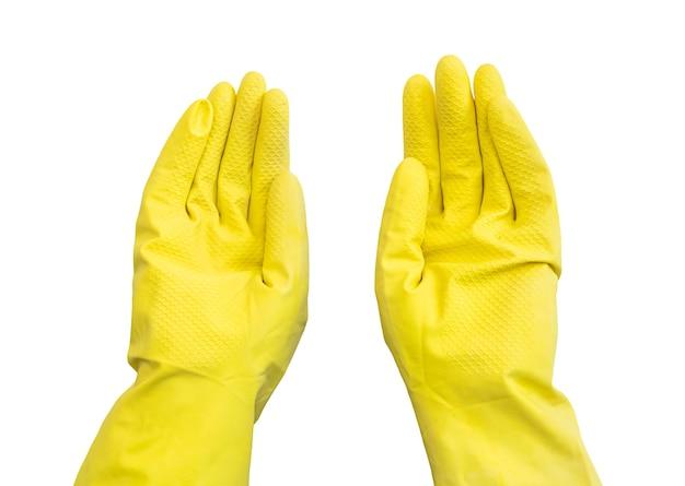 Руки в желтых перчатках, изолированные на белом фоне фото